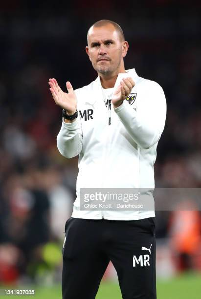 Mark Robinson, Manager of AFC Wimbledon applauds the fans after the Carabao Cup Third Round match between Arsenal and AFC Wimbledon at Emirates...