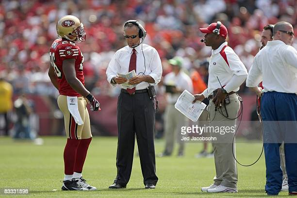 Mark Roman of the San Francisco 49ers listens to head coach Mike Nolan during the game against the New England Patriots on October 5 2008 at...