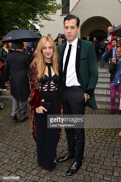 Mark Ronson and Josephine de la Baume arrive for the wedding of Maria Theresia Princess von Thurn und Taxis and Hugo Wilson at St Joseph Church in...