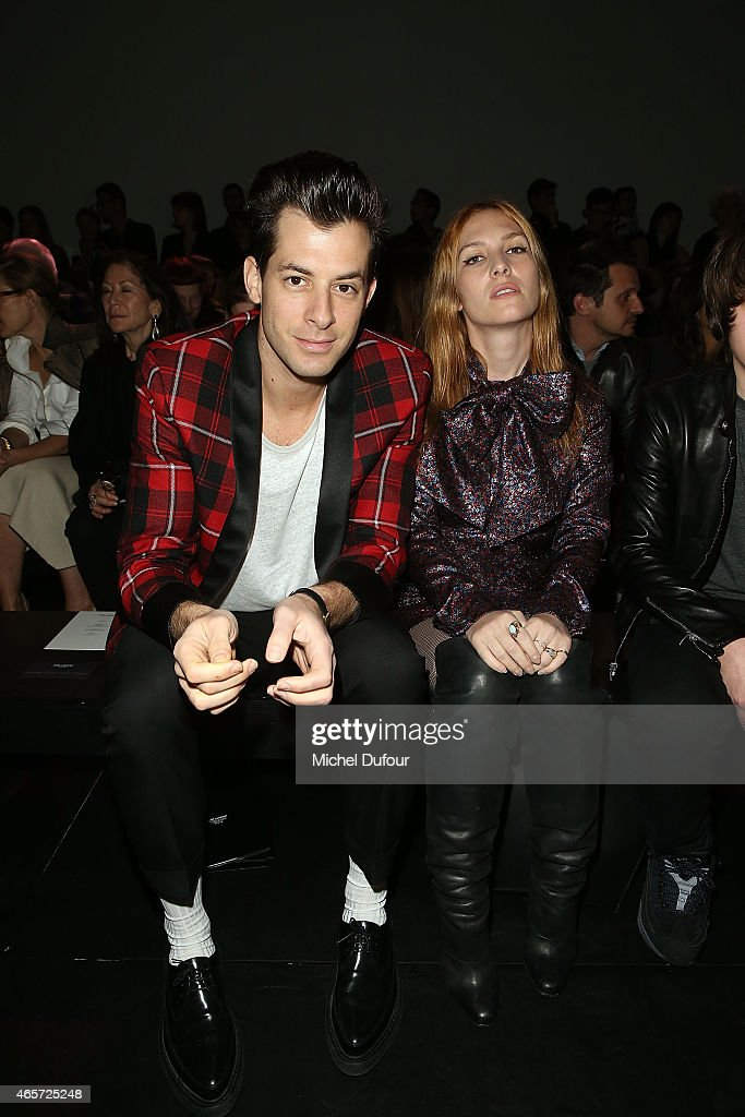 Mark Ronson and Josephine de la Baume attend the Saint Laurent show as part of the Paris Fashion Week Womenswear Fall/Winter 2015/2016 on March 9, 2015 in Paris, France.