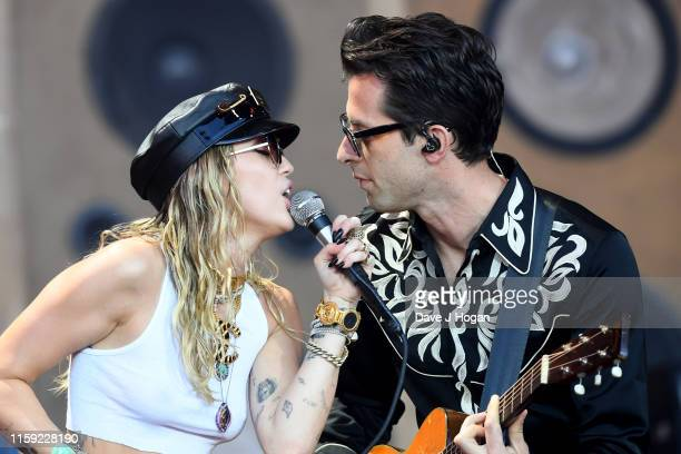 Mark Ronson and Miley Cyrus perform on the Pyramid stage during day five of Glastonbury Festival at Worthy Farm Pilton on June 30 2019 in Glastonbury...