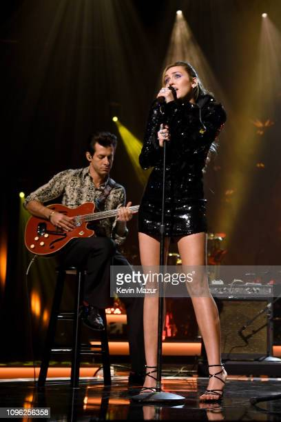 Mark Ronson and Miley Cyrus perform onstage during MusiCares Person of the Year honoring Dolly Parton at Los Angeles Convention Center on February 8...
