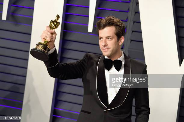 """Mark Ronson poses with the 'Original Song' Oscar for """"Shallow"""" A Star Is Born during the 2019 Vanity Fair Oscar Party hosted by Radhika Jones at..."""