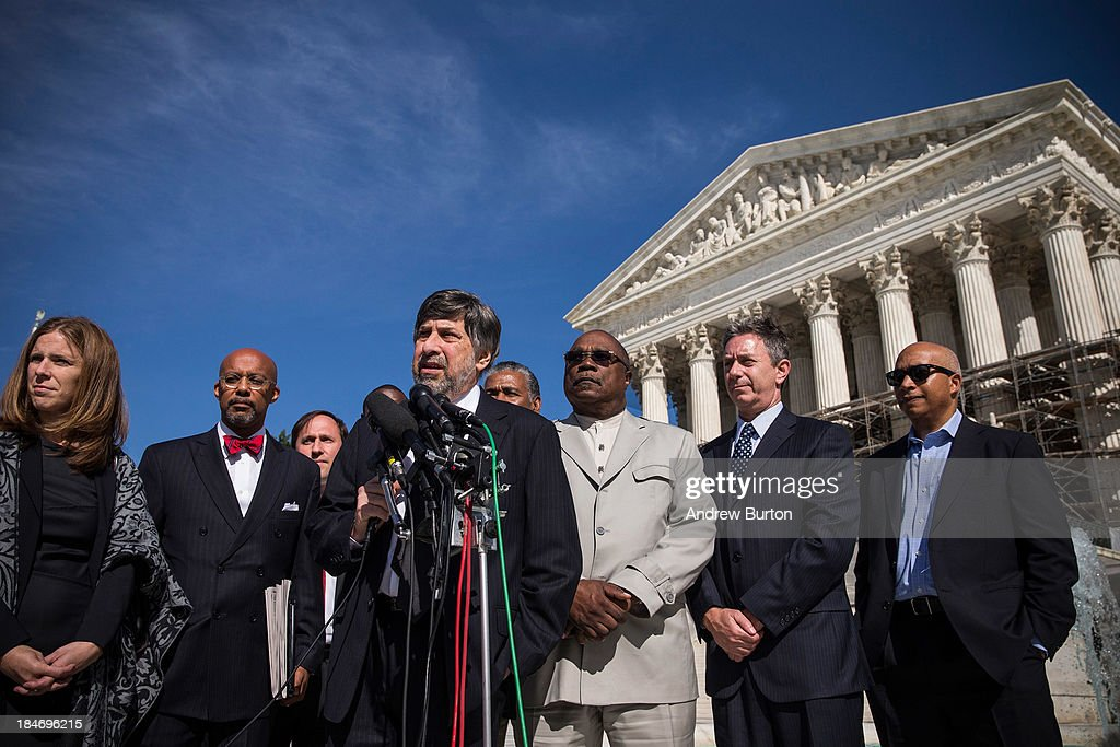 Mark Rosenbaum (C), chief counsel for the American Civil Liberties Union of Southern California and lawyer representing the Coalition to Defend Affirmative Action speaks during a press conference outside the U.S. Supreme Court after the going before the Supreme Court in 'Schuette v. Coalition to Defend Affirmative Action' on October 15, 2013 in Washington, DC. The case revolves around affirmative action and whether or not states have the right to ban schools from using race as a consideration in school admissions.