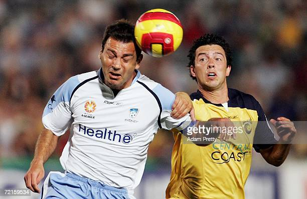 Mark Rudan of Sydney FC heads the ball under pressure form John Hutchinson of the Mariners during the round eight Hyundai A-League match between the...