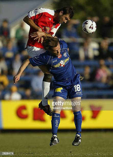 Mark Rudan of United heads the ball away from Michael Curcija of South Melbourne during the round 19 NSL match between the South Melbourne and Sydney...