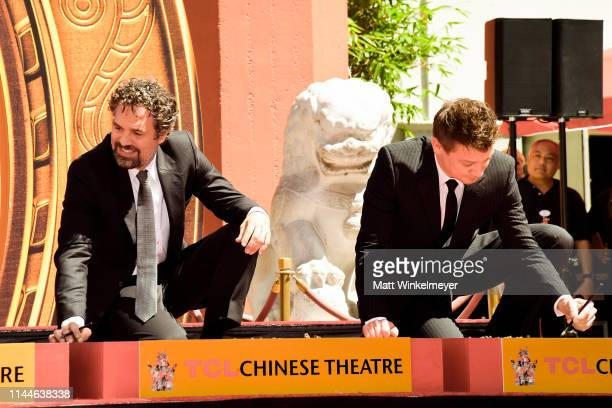Mark Ruffalo and Jeremy Renner pose at the Marvel Studios' 'Avengers Endgame' Cast Place Their Hand Prints In Cement At TCL Chinese Theatre IMAX...