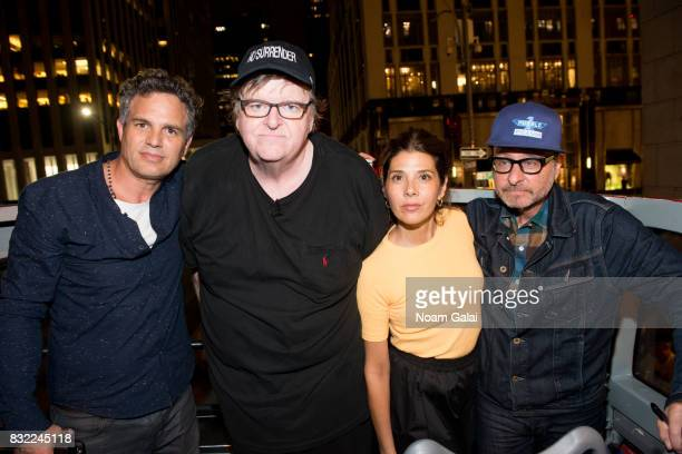 Mark Ruffalo Marisa Tomei and Fisher Stevens join Michael Moore as he leads his Broadway audience to Trump Tower to protest President Donald Trump on...
