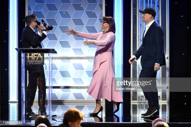 Mark Ruffalo presents the Hollywood Blockbuster Award to Victoria Alonso and Kevin Feige onstage during the 23rd Annual Hollywood Film Awards at The...