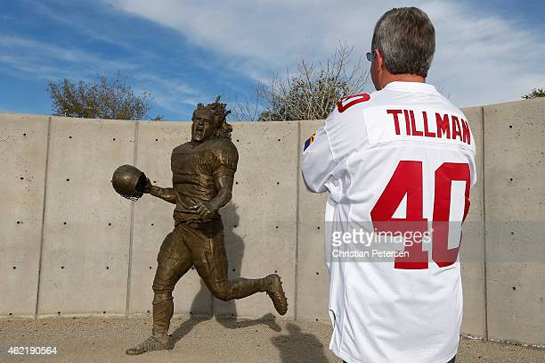 Mark Ryan of Phoenix Az looks at the statue of Pat Tillman before the 2015 Pro Bowl at University of Phoenix Stadium on January 25 2015 in Glendale...