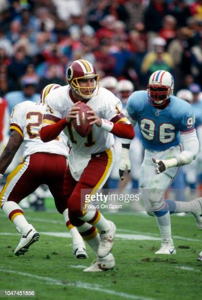 Mark Rypien of the Washington Redskins drops back to pass against the Houston Oilers during an NFL football game November 3 1991 at RFK Stadium in...