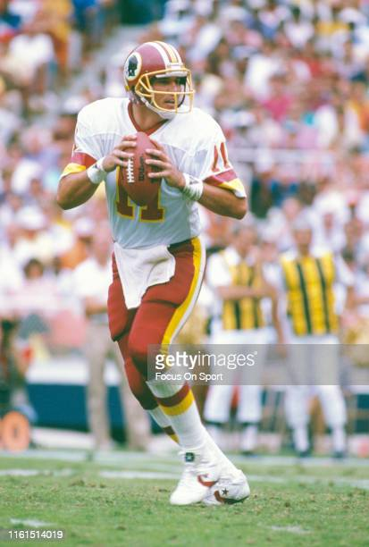 Mark Rypien of the Washington Redskins drops back to pass against the New York Giants during an NFL football game October 2 1988 at RFK Stadium in...