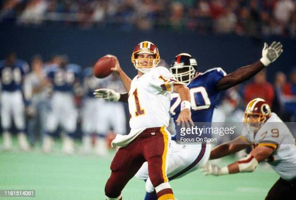 Mark Rypien of the Washington Redskins drops back to pass against the New York Giants during an NFL football game October 27 1991 at Giants Stadium...
