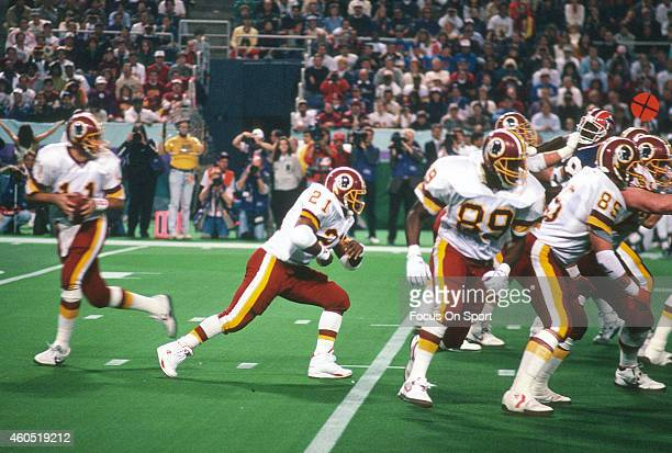 Mark Rypien of the Washington Redskins drops back to pass against the Buffalo Bills during Super Bowl XXVI at the Metrodome in Minneapolis Minnesota...