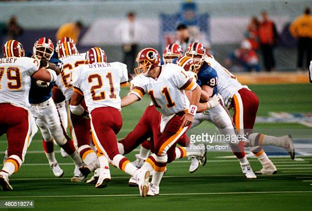 Mark Rypien of the Washington Redskins hands off to Earnest Byner against the Buffalo Bills during Super Bowl XXVI at the Metrodome in Minneapolis...