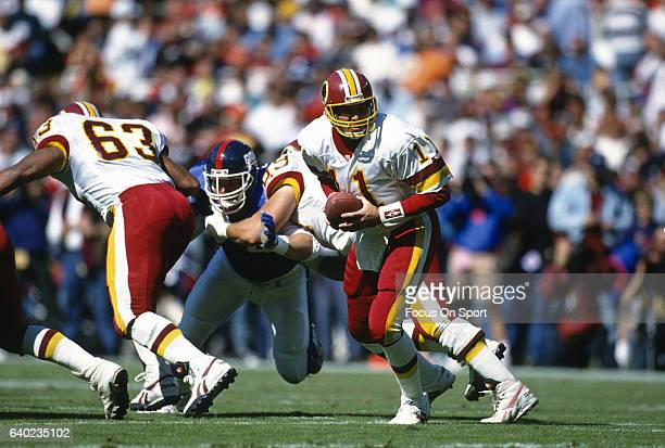 Mark Rypien of the Washington Redskins in action against the New York Giants during an NFL football game October 10 1993 at RFK Stadium in Landover...