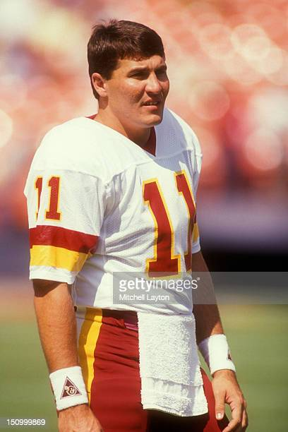 Mark Rypien of the Washington Redskins looks on before a football game against the Philadelphia Eagles on October 21 1990 at RFK Stadium in...