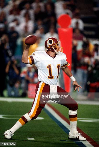 Mark Rypien of the Washington Redskins looks to pass against the Buffalo Bills during Super Bowl XXVI at the Metrodome in Minneapolis Minnesota...