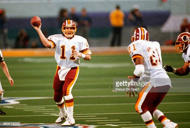 Mark Rypien of the Washington Redskins looks to pass to Earnest Byner against the Buffalo Bills during Super Bowl XXVI at the Metrodome in...
