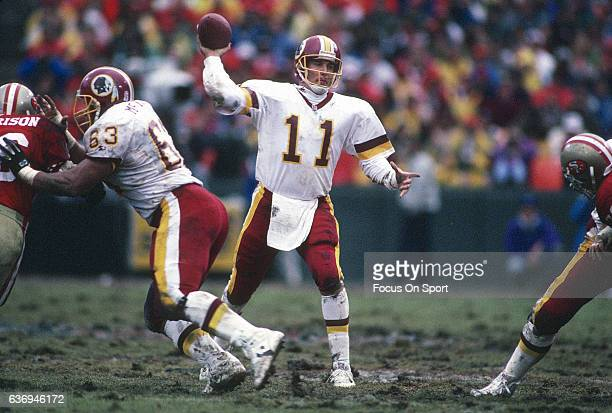 Mark Rypien of the Washington Redskins throws a pass against the San Francisco 49ers during the NFC Divisional Playoffs January 9 1993 at Candlestick...