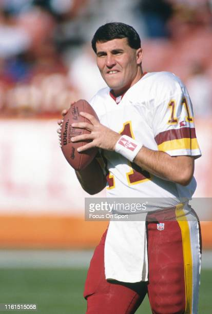 Mark Rypien of the Washington Redskins warms up prior to the start of an NFL football game against the Los Angeles Rams on December 1 1991 at Anaheim...