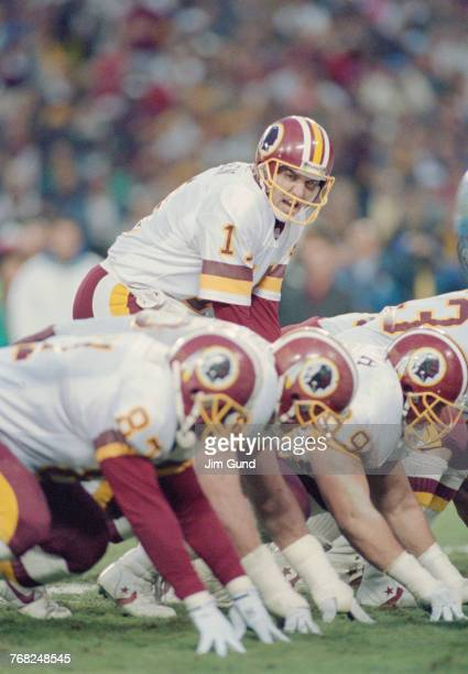 Mark Rypien Quarterback for the Washington Redskins calls the play on the line of scrimmage during the National Football Conference Championship game...