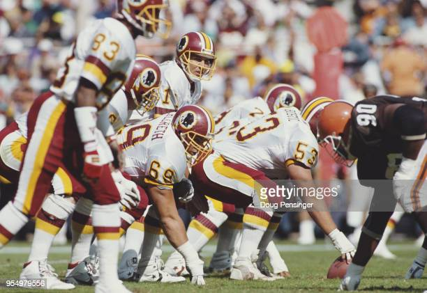 Mark Rypien Quarterback for the Washington Redskins calls the play on the line of scrimmage during the National Football Conference East game against...