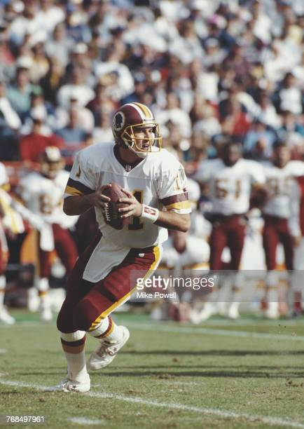 Mark Rypien Quarterback for the Washington Redskins runs the ball during the National Football Conference West game against the Los Angeles Rams on 1...