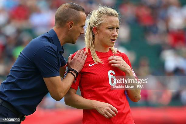 Mark Sampson coach of England talks with Laura Bassett during the FIFA Women's World Cup 2015 third place playoff match between Germany and England...