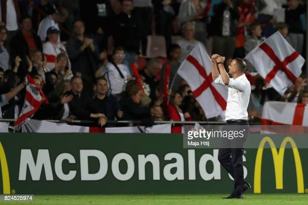 Mark Sampson head coach of England celebrates victory with the England fans after the UEFA Women's Euro 2017 Quarter Final match between France and...