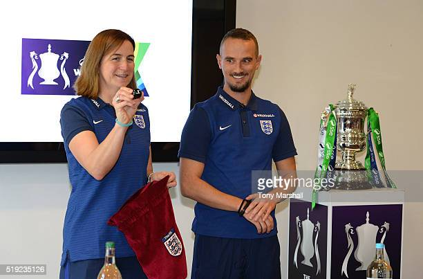 Mark Sampson Head Coach of England Women and Marianne Spacey Assistant Coach of England Women make the draw for the SSE Women's FA Cup SemiFinals...