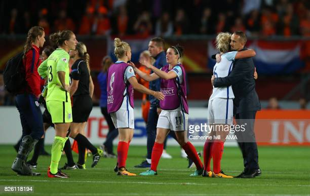 Mark Sampson manager / head coach of England Women hugs Millie Bright as the team stand dejected after the UEFA Women's Euro 2017 semi final match...