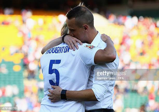 Mark Sampson of England consoles Steph Houghton after losing to Japan during the FIFA Women's World Cup 2015 Semi Final match between Japan and...
