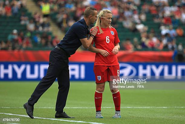 Mark Sampson of England talks too Laura Bassett during the FIFA Women's World Cup 2015 Third Place Playoff match between Germany and England at...