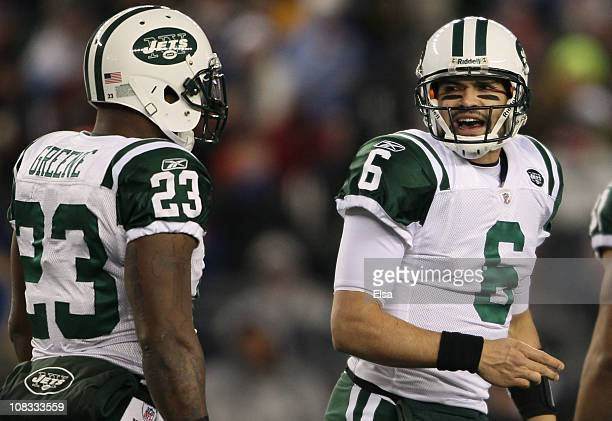 Mark Sanchez and Shonn Greene of the New York Jets reacts to a play against the New England Patriots during their 2011 AFC divisional playoff game at...