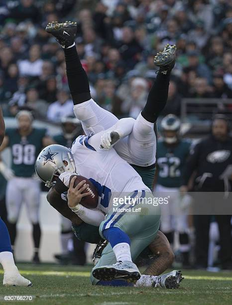 Mark Sanchez of the Dallas Cowboys is sacked by Marcus Smith of the Philadelphia Eagles in the second quarter at Lincoln Financial Field on January 1...