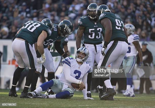 Mark Sanchez of the Dallas Cowboys reacts around Connor Barwin Jordan Hicks Nigel Bradham and Fletcher Cox of the Philadelphia Eagles in the second...