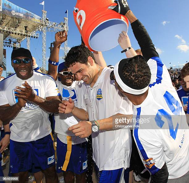 Mark Sanchez of the New York Jets celebrates at the Fourth Annual DIRECTV Celebrity Beach Bowl at DIRECTV Celebrity Beach Bowl Stadium South Beach on...