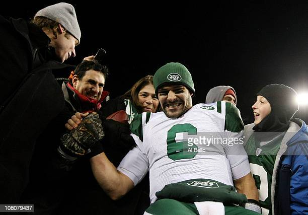 Mark Sanchez of the New York Jets celebrates with fans after the Jets defeated the Patriots 28 to 21 in their 2011 AFC divisional playoff game at...