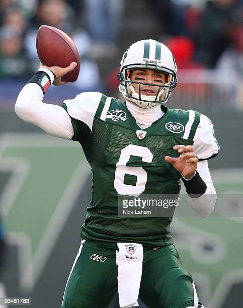 Mark Sanchez of the New York Jets drops back to pass against the Carolina Panthers at Giants Stadium on November 29 2009 in East Rutherford New Jersey