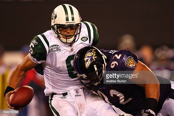 Mark Sanchez of the New York Jets gets sacked by Haloti Ngata of the Baltimore Ravens during their home opener at the New Meadowlands Stadium on...