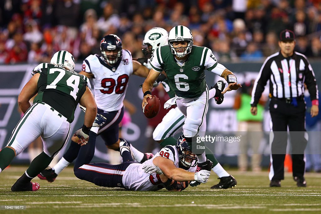 Mark Sanchez #6 of the New York Jets is sacked by J.J. Watt #99 of the Houston Texans in the fourth quarter at MetLife Stadium on October 8, 2012 in East Rutherford, New Jersey. The Texans won 23-17.