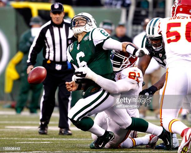 Mark Sanchez of the New York Jets is sacked by Tamba Hali of the Kansas City Chiefs during their game at MetLife Stadium on December 11 2011 in East...