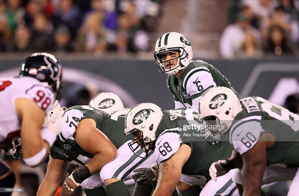 Mark Sanchez #6 of the New York Jets looks down the line of scrimmage against the Houston Texans at MetLife Stadium on October 8, 2012 in East Rutherford, New Jersey.