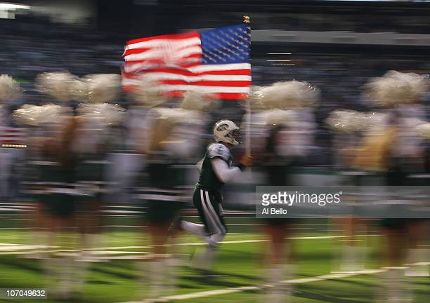 Mark Sanchez of the New York Jets runs on the field against the Houston Texans before their game on November 21 2010 at the New Meadowlands Stadium...