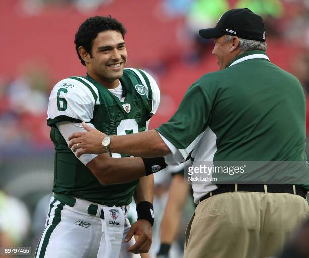 Mark Sanchez of the New York Jets shakes hands with head coach Rex Ryan prior to the preseason game against the St Louis Rams at Giants Stadium on...