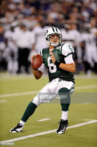 Mark Sanchez of the New York Jets throws a pass in a preseason game against the Baltimore Ravens at MT Bank Stadium on August 24 2009 in Baltimore...