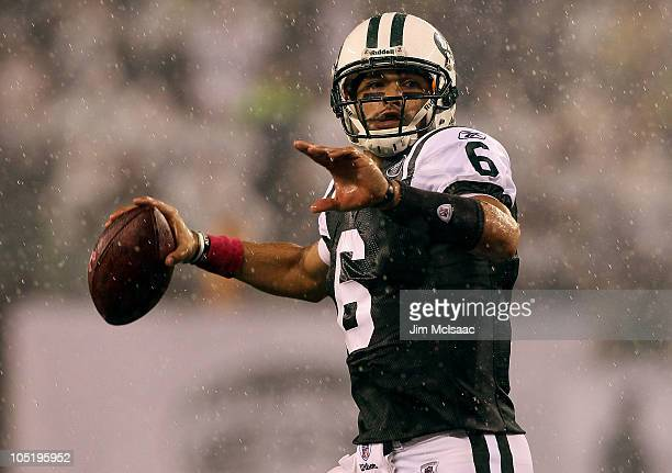 Mark Sanchez of the New York Jets throws a pass in the rain during the second quarter against the Minnesota Vikings at New Meadowlands Stadium on...