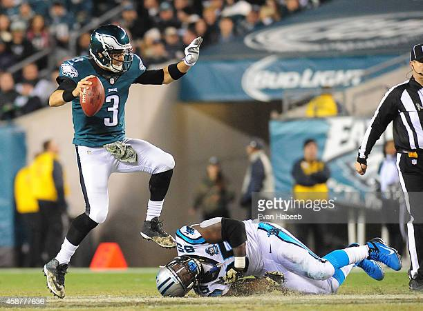 Mark Sanchez of the Philadelphia Eagles avoids the tackle by Charles Johnson of the Carolina Panthers on November 10 2014 at Lincoln Financial Field...