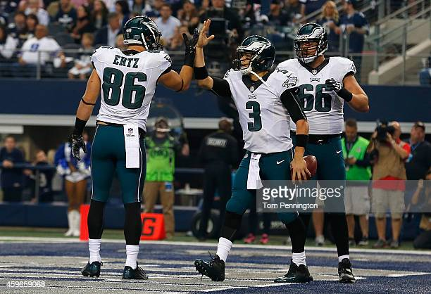 Mark Sanchez of the Philadelphia Eagles is congratulated by Zach Ertz of the Philadelphia Eagles as Andrew Gardner of the Philadelphia Eagles is near...